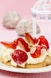 Delicious strawberry cake on party table Stock Images