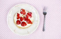 Delicious strawberry cake on party table Royalty Free Stock Photos