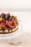 Delicious strawberry cheesecake on white wooden background. Stock Photos