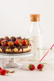 Delicious strawberry cheesecake on white wooden background. Royalty Free Stock Photo