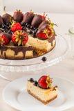 Delicious strawberry cheesecake on white wooden background. Royalty Free Stock Photos