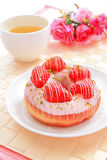 Delicious strawberry doughnuts with tea Stock Photo