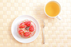 Delicious strawberry doughnuts with tea Stock Photography
