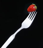 Delicious strawberry on a fork Royalty Free Stock Photography