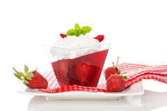 Delicious strawberry jelly dessert. Delicious strawberry jelly dessert on white background. Culinary healthy sweet dessert eating Royalty Free Stock Images