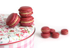 Delicious Strawberry Macarons. Red macarons on a can on white background Stock Photo