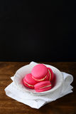 Delicious strawberry macaroon in a plate. Dessert Royalty Free Stock Photography