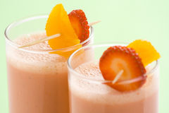 Delicious strawberry orange banana milkshake Royalty Free Stock Images