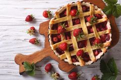 Delicious strawberry pie in a baking dish vertical top view Royalty Free Stock Photo