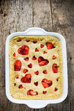 Delicious strawberry pie with heart decorations on Valentine Day Stock Image