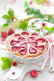Delicious strawberry tart or cheesecake with fresh berries and cream cheese, closeup Stock Image