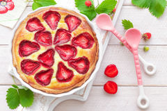 Delicious strawberry tart or cheesecake with fresh berries and cream cheese, closeup Stock Photography