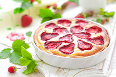 Delicious strawberry tart or cheesecake with fresh berries and cream cheese, closeup Royalty Free Stock Photos