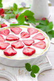 Delicious strawberry tart or cheesecake with fresh berries and cream cheese, closeup Stock Photos