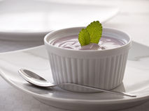 Delicious strawberry yogurt. Strawberry yogurt decorated with fresh mint leaves Stock Photography