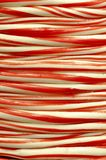 Candy cane bobbin stripped closeup. Delicious long candy cane bobbin closeup at the confectioners shop Stock Image