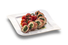 Delicious stuffed chicken roll decorated with roasted cherry tom Royalty Free Stock Photo