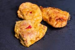 Stuffed fried peppers on black slate. stock photo