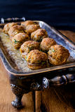 Delicious Stuffed Mushrooms. Delicious baked stuffed mushrooms in a silver serving dish Royalty Free Stock Photos