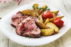 Delicious succulent rare beef steak Stock Image