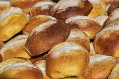 Sugary brioches ready for breakfast in the morning. Delicious sugary brioches ready for breakfast in the morning Royalty Free Stock Photos