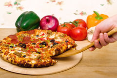 Delicious supreme pizza. With meat and vegetables stock image