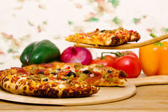 Delicious supreme pizza Royalty Free Stock Photos