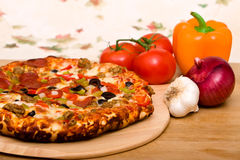 Delicious supreme pizza. With meat and vegetables royalty free stock photos
