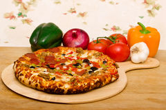 Delicious supreme pizza Royalty Free Stock Photography