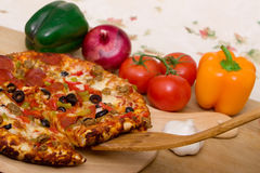 Delicious supreme pizza Stock Images