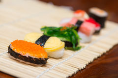 Delicious sushi on bamboo mat Stock Images