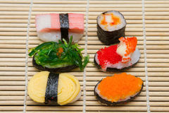 Delicious sushi on bamboo mat Stock Photos