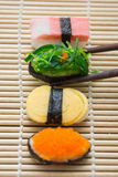 Delicious sushi on bamboo mat Royalty Free Stock Photo