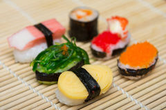Delicious sushi on bamboo mat Royalty Free Stock Photos