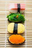 Delicious sushi on bamboo mat Royalty Free Stock Photography