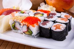 Delicious sushi with caviar wasabi and chopsticks Royalty Free Stock Image