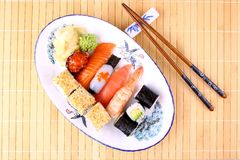 Delicious sushi with chopsticks and red caviar, close up Stock Photo