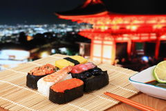 Delicious  sushi mix with  japan red temple Royalty Free Stock Photography