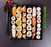 Delicious sushi pieces served on black stone Stock Images
