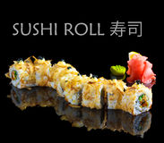 Delicious sushi roll on a black background Stock Photos
