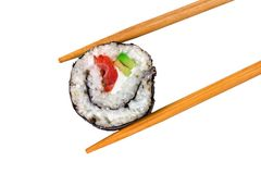 Sushi roll in chopstick on white. Delicious sushi roll in chopstick isolated on white stock images