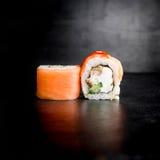Delicious sushi rolls on black background. Japanese food. Delicious sushi rolls on black background Royalty Free Stock Image