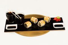 Delicious sushi rolls on dish on studio stock photography
