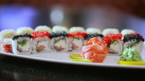 Sushi dish on black table in motion rolls set presentation stock footage