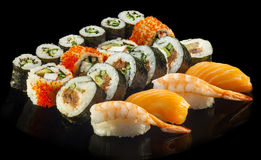Delicious Sushi rolls with shrimp, salmon, tuna Royalty Free Stock Photography