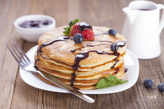 Delicious sweet American pancakes on a plate with fresh fruits Royalty Free Stock Photos