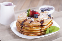 Delicious sweet American pancakes on a plate with fresh fruits Royalty Free Stock Images
