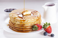 Delicious sweet American pancakes on a plate with fresh fruits Royalty Free Stock Photography