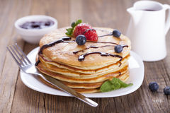 Delicious sweet American pancakes on a plate with fresh fruits Stock Photos