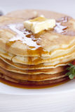 Delicious sweet American pancakes on a plate with fresh fruits Stock Photography